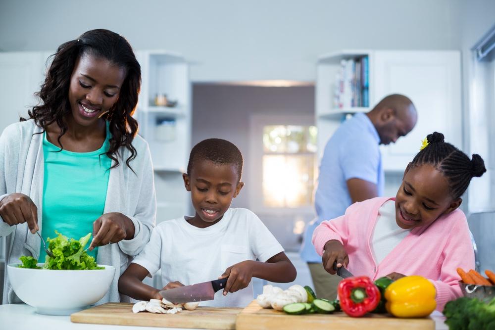 Family preparing meal kit dinner in kitchen.jpeg